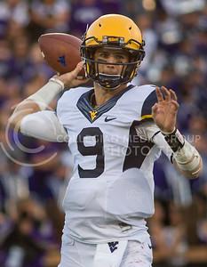 Photo by Emily DeShazer | The Collegian  West Virginia junior quarterback Clint Trickett pulls back to throw on Saturday Oct. 26 at Bill Snyder Family Stadium.