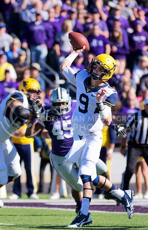 Photo by Jed Barker | The Collegian  West Virginia quarterback Clint Trickett throws the ball at Bill Snyder Family Stadium on October 26, 2013.