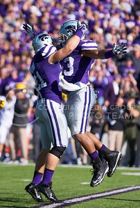 Photo by Jed Barker | The Collegian  K-State linebackers Jonathan Truman (left) and Black Slaughter (right) celebrate after the defense stops West Virginia on 3rd down at Bill Snyder Family Stadium on October 26, 2013.