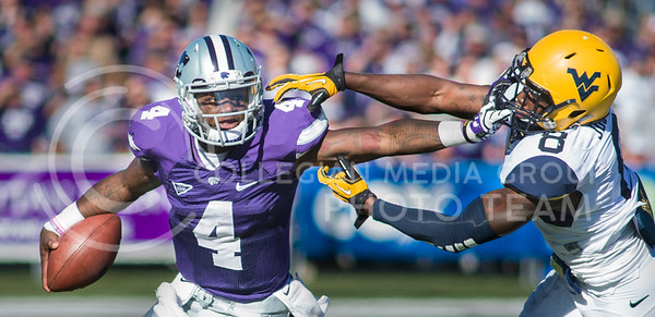 Photo by Emily DeShazer | The Collegian  Sophomore quarterback Daniel Sams stiff arms West Virginia sophomore safety Karl Joseph on Saturday Oct. 26 at Bill Snyder Family Stadium.
