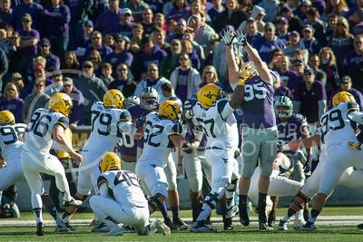 Photo by Emily DeShazer | The Collegian  Sophomore defensive lineman Travis Britz blocks a point after attempt on Saturday Oct. 26 at Bill Snyder Family Stadium.