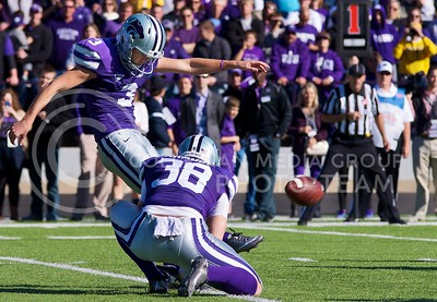 Photo by Jed Barker | The Collegian  K-State place kicker Jack Cantele kicks the ball for the extra point after K-State scored its first touchdown during the first quarter at Bill Snyder Family Stadium on October 26, 2013.