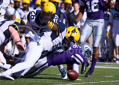 Photo by Jed Barker | The Collegian  K-State quarterback Jake Waters fumbles the ball that is then recovered by West Virginia during the first quarter at Bill Snyder Family Stadium on October 26, 2013.