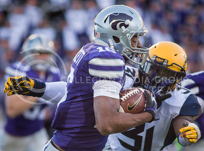 Photo by Emily DeShazer | The Collegian  Junior wide receiver Tyler Lockett pushes away West Virginia sophomore linebacker Isaiah Bruce on Saturday Oct. 26 at Bill Snyder Family Stadium.
