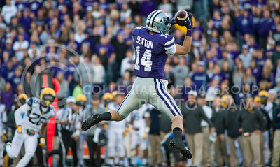 Photo by Emily DeShazer | The Collegian  Junior wide receiver Curry Sexton catches a pass from junior quarterback Jake Waters on Saturday at Bill Snyder Family Stadium.
