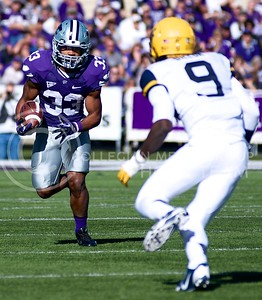 Photo by Jed Barker | The Collegian  K-State running back John Hubert rushes the ball against West Virginia at Bill Snyder Family Stadium on October 26, 2013.