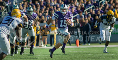 Photo by Emily DeShazer | The Collegian  Junior quarterback Jake Waters rushes towards the endzone on Saturday Oct. 26 at Bill Snyder Family Stadium.