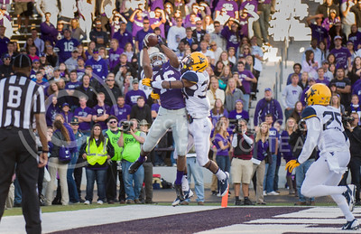 Photo by Emily DeShazer | The Collegian  Junior wide receiver Tyler Lockett catches a touchdown as junior West Virginia cornerback Ishmael Banks  defends on Saturday at Bill Snyder Family Stadium.