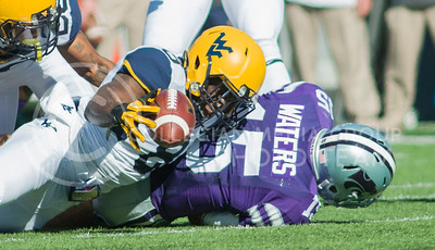 Photo by Emily DeShazer | The Collegian  West Virginia sophomore safety Karl Joseph recovers a fumble by junior quarterback Jake Waters early in the first quarter on Saturday Oct. 26 at Bill Snyder Family Stadium.