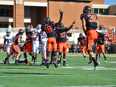 (Photo by Parker Robb |  Collegian)  Oklahoma State players celebrate after recovering a fumble on K-State's kickoff return at the end of the first half of the Wildcats' game against Oklahoma State in Stillwater, Oklahoma, Saturday afternoon. The fumble was eventually ruled an illegal forward pass, and after the penalty, K-State kneeled on two plays to end the first half down by three, 17-14. The Wildcats' game was marred by an unusually-high twelve penalties and five turnovers.