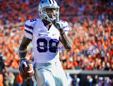 (Photo by Parker Robb |  Collegian)  K-State wide receiver Torell Miller quiets the OSU crowd after his touchdown catch and rush in the third quarter of the Wildcats' game against Oklahoma State in Stillwater, Oklahoma, Saturday afternoon. The Cowboys beat the Wildcats 33-29 in a tense game that went down to the wire, sealing their win with an interception with eighteen seconds remaining.
