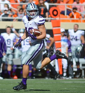 (Photo by Parker Robb |  Collegian)  K-State fullback Glenn Gronkowski looks to see if anyone is catching him as he runs down the field to score and put K-State on the board first during the first quarter of the Wildcats' game against Oklahoma State in Stillwater, Oklahoma, Saturday afternoon. Despite twelve penalties and five turnovers, K-State kept the game close to the very end.