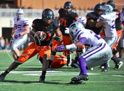 (Photo by Parker Robb |  Collegian)  K-State defensive back Dante Barnett rushes to tackle OSU running back Jeremy Smith during the second quarter of the Wildcats' game against Oklahoma State in Stillwater, Oklahoma, Saturday afternoon. The Cowboys beat the Wildcats 33-29 in a tense game that went down to the wire, sealing their win with an interception with eighteen seconds remaining.