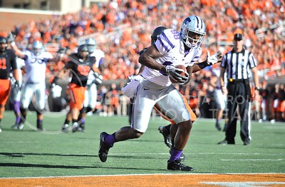 (Photo by Parker Robb |  Collegian)  K-State wide receiver Torell Miller strides into the endzone to put the Wildcats up 21-17 during the third quarter of the Wildcats' game against Oklahoma State in Stillwater, Oklahoma, Saturday afternoon. The Cowboys beat the Wildcats 33-29 in a tense game that went down to the wire, sealing their win with an interception with eighteen seconds remaining.