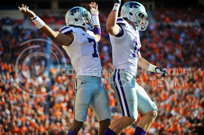 (Photo by Parker Robb |  Collegian)  K-State defenisve back Kip Daily (left) celebrates with defensive back Ty Zimmerman after holding OSU to a three-and-out during the fourth quarter of the Wildcats' game against Oklahoma State in Stillwater, Oklahoma, Saturday afternoon. The Cowboys beat the Wildcats 33-29 in a tense game that went down to the wire, sealing their win with an interception with eighteen seconds remaining.