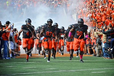 (Photo by Parker Robb |  Collegian)  The Oklahoma State Cowboys surge from the tunnel and take to the field before their game against the K-State Wildcats Saturday afternoon in Stillwater, Oklahoma.