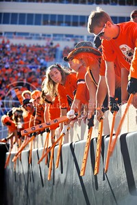 (Photo by Parker Robb |  Collegian)  OSU students annoyingly bang wooden paddles against the padding on the wall separating them from the field during the third quarter of the Wildcats' game against Oklahoma State in Stillwater, Oklahoma, Saturday afternoon. The Cowboys beat the Wildcats 33-29 in a tense game that went down to the wire, sealing their win with an interception with eighteen seconds remaining.