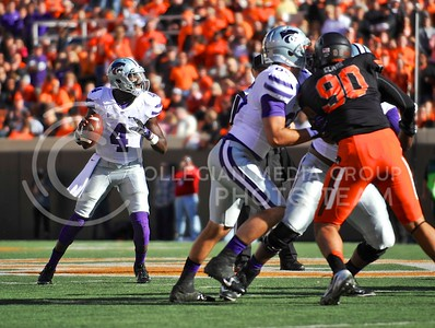 (Photo by Parker Robb |  Collegian)  K-State quarterback Daniel Sams looks for receivers downfield during the third quarter of the Wildcats' game against Oklahoma State in Stillwater, Oklahoma, Saturday afternoon. The Cowboys beat the Wildcats 33-29 in a tense game that went down to the wire, sealing their win with an interception with eighteen seconds remaining.