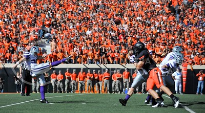 (Photo by Parker Robb |  Collegian)  K-State punter Mark Krause kicks the ball downfield from K-State's end of the field after a failed three-and-out at the end of the first quarter of the Wildcats' game against Oklahoma State in Stillwater Saturday afternoon. The Cowboys beat the Wildcats 33-29 in a tense game that went down to the wire, sealing their win with an interception with eighteen seconds remaining.