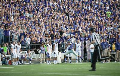 (Photo by Taylor Alderman / The Collegian)  Junior wide receiver Tyler Locket catches a touchdown pass as the crowd goes wild Nov. 16, 2013 at Bill Snyder Family Stadium.