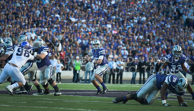 (Photo by Taylor Alderman / The Collegian)  Junior quarterback Jake Waters looks to pass down field on Nov. 16, 2013 at Bill Snyder Family Stadium.