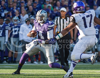 (Photo by Taylor Alderman / The Collegian)  Sophomore quarterback Daniel Sams looks for a hole in TCU's defensive line on Nov. 16, 2013 at Bill Snyder Family Stadium.