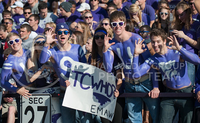 (Photo by Taylor Alderman / The Collegian)  Students smile for the camera on Nov. 16, 2013 at Bill Snyder Family Stadium.