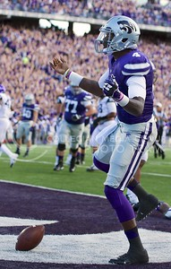 Photo by Jed Barker | The Collegian  Sophomore quarterback Daniel Sams celebrates after scoring a touchdown against TCU at Bill Snyder Family Stadium on November 16, 2013.