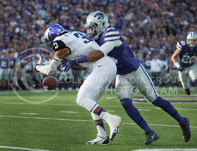 (Photo by Taylor Alderman / The Collegian)  Junior defensive back Randall Evans breaks up a pass intended for TCU junior wide reciver Brandon Carter on Nov. 16, 2013 at Bill Snyder Family Stadium.