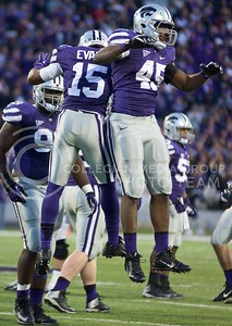 Photo by Jed Barker | The Collegian  Junior defensive back Randall Evans and sophomore defensive end  Marquel Bryant celebrate after Evans sacked TCU quarterback Casey Pachall at Bill Snyder Family Stadium on November 16, 2013.