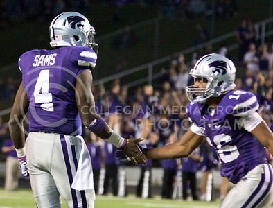 Photo by Jed Barker | The Collegian  Junior wide receiver Tyler Lockett congratulates sophomore quarterback Daniel Sams after Sams leaped over a TCU defender to get the first down and keep the drive alive at Bill Snyder Family Stadium on November 16, 2013.