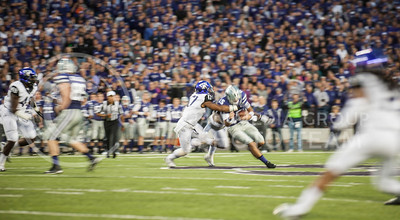 (Photo by Taylor Alderman / The Collegian)  Junior quarterback Jake Waters is tackled by TCU junior safety Sam Carter on Nov. 16, 2013 at Bill Snyder Family Stadium.