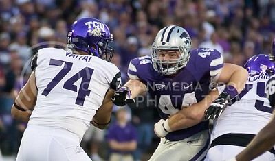 Photo by Jed Barker | The Collegian  K-State defensive end, junior Ryan Mueller tries to push past the TCU linebackers during the game against the Horned Frogs at Bill Snyder Family Stadium on November 16, 2013.