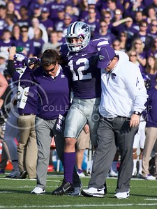 Photo by Jed Barker | The Collegian  Senior free safety Ty Zimmerman is escorted off the field after being injured during the game against the TCU Horned Frogs on November 16, 2013. Zimmerman did not return for the remainder of the game due to an apparent foot injury.