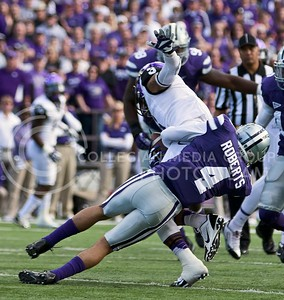 Photo by Jed Barker | The Collegian  K-State senior cornerback Dorrian Roberts tackles TCU wide receiver Brandon Carter at Bill Snyder Family Stadium on November 16, 2013.