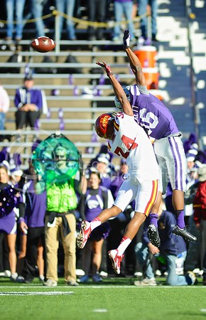 (Photo by Parker Robb | Collegian)  Junior wide receiver Tyler Lockett battles Iowa State defensive back Nigel Tribune for a catch, which was actually caught by senior wide receiver Tramaine Thompson just outside the photo to the left, during the second quarter of the Wildcats' win over the Iowa State Cyclones Saturday afternoon in Bill Snyder Family Stadium.