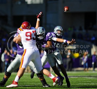 (Photo by Parker Robb | Collegian)  Junior quarterback Jake Waters throws a pass during the first quarter of the Wildcats' win over the Iowa State Cyclones Saturday afternoon in Bill Snyder Family Stadium. Waters finished the game completing 9 of 15 pass attempts for 157 yards.