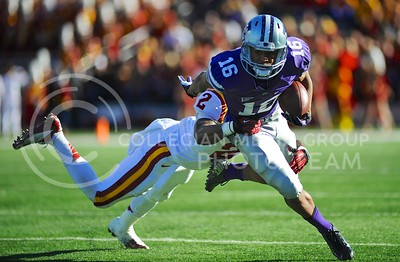(Photo by Parker Robb | Collegian)  Junior wide receiver Tyler Lockett runs the ball after a catch for a total of six yards during the first quarter of the Wildcats' win over the Iowa State Cyclones Saturday afternoon in Bill Snyder Family Stadium. Quarterback Daniel Sams later ran for one yard to put K-State up 17-0.