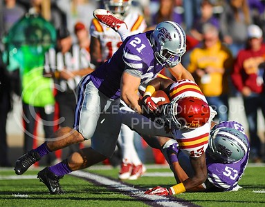 "(Photo by Parker Robb | Collegian)  Junior linebacker Jonathan Truman (21) and senior linebacker Blake Slaughter (53) bring down Iowa State wide receiver Dondre Daley during the third quarter of the Wildcats' win over the Iowa State Cyclones Saturday afternoon in Bill Snyder Family Stadium. The Wildcats defeated the Cyclones 41-7 in their rivalry known as ""Farmageddon."""