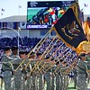 Parker Robb | The Collegian  The Fort Riley color guard displays the flags of its various constituent units on the field during Fort Riley Day festivities before the football game against Iowa State November 2, 2013, at Bill Snyder Family Stadium.