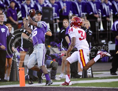 (Photo by Parker Robb | Collegian)  Junior wide receiver Tyler Lockett attempts to haul in a pass during the fourth quarter of the Wildcats' win over the Iowa State Cyclones Saturday afternoon in Bill Snyder Family Stadium. On the next play, senior wide receiver Tramaine Thompson caught a pass on the 3-yard line to set up a K-State touchdown.