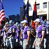 Parker Robb | The Collegian<br /> <br /> The K-State football team emerges from the locker rooms carrying the American, Kansas, First Infantry Division and Fort Riley flags before the Fort Riley Day football game against Iowa State November 2, 2013, at Bill Snyder Family Stadium.
