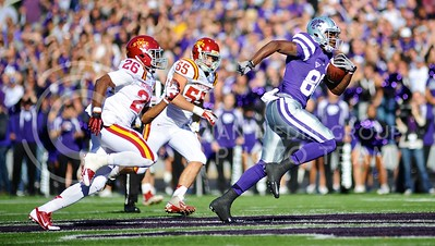 "(Photo by Parker Robb | Collegian)  Senior wide receiver Torell Miller leaves two Iowa State defenders in his dust as he sprints for a 37-yard reception during the first quarter of the Wildcats' win over the Iowa State Cyclones Saturday afternoon in Bill Snyder Family Stadium. The Wildcats defeated the Cyclones 41-7 in their rivalry known as ""Farmageddon."""