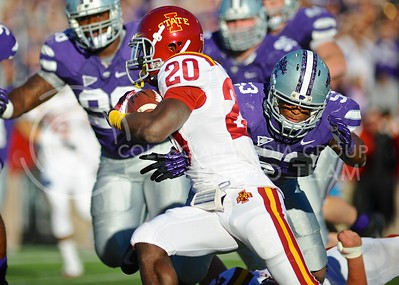 "(Photo by Parker Robb | Collegian)  Senior linebacker Blake Slaughter lunges for running back DeVondrick Nealy during the fourth quarter of the Wildcats' win over the Iowa State Cyclones Saturday afternoon in Bill Snyder Family Stadium. The Wildcats defeated the Cyclones 41-7 in their rivalry known as ""Farmageddon."""