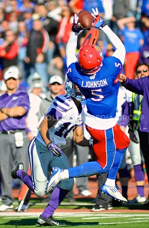 (Photo by Parker Robb | Collegian)  KU safety Isaiah Johnson snatches a pass out of the air before junior wide receiver Tyler Lockett can get to it, recording K-State quarterback Jake Waters' only interception of the game, during the third quarter of the annual Sunflower Showdown Saturday in Memorial Stadium in Lawrence. Three plays later, K-State got the ball back when sophomore defensive back Dante Barnett caught his first interception of the game. The Wildcats beat the Kansas Jayhawks 31-10, bringing their current win streak in the series against their intrastate rivals to five.