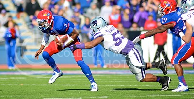Senior linebacker Blake Slaughter dives to tackle (Photo by Parker Robb | Collegian)  KU quarterback Montell Cozart during the first quarter of the annual Sunflower Showdown Saturday in Memorial Stadium in Lawrence. The Wildcats beat the Kansas Jayhawks 31-10, bringing their current win streak in the series against their intrastate rivals to five. Slaughter recorded 15 tackles, the most of any K-State player since 2003.