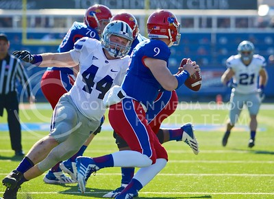 (Photo by Parker Robb | Collegian)  Junior defensive end Ryan Mueller prepares to sack KU quarterback Jake Heaps for a loss of ten yards during the first quarter of the annual Sunflower Showdown Saturday in Memorial Stadium in Lawrence. The Wildcats beat the Kansas Jayhawks 31-10, bringing their current win streak in the series against their intrastate rivals to five. Mueller is now tied for the K-State sacks per season record at 11.5 sacks this season.