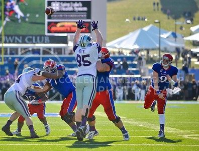 (Photo by Parker Robb | Collegian)  Sophomore defensive lineman Travis Britz attempts to knock down a pass from KU quarterback Jake Heaps during the second quarter of the annual Sunflower Showdown Saturday in Memorial Stadium in Lawrence. The Wildcats beat the Kansas Jayhawks 31-10, bringing their current win streak in the series against their intrastate rivals to five.