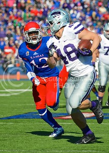 (Photo by Parker Robb | Collegian)  Redshirt freshman Glenn Gronkowski outruns KU cornerback Dexter McDonald to score K-State's third touchdown after catching a pass from junior quarterback Jake Waters during the second quarter of the annual Sunflower Showdown Saturday in Memorial Stadium in Lawrence. The Wildcats beat the Kansas Jayhawks 31-10, bringing their current win streak in the series against their intrastate rivals to five.