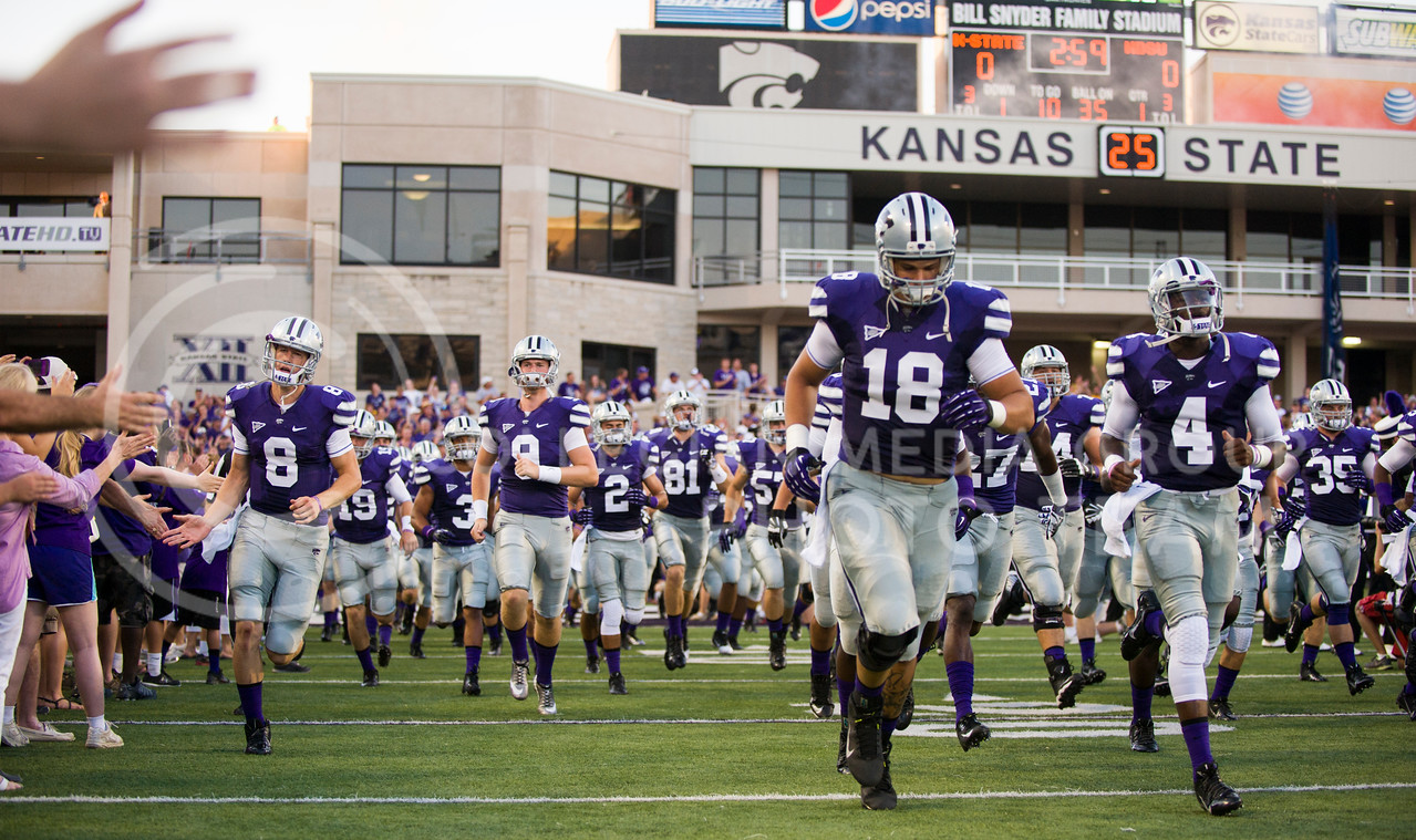 (Photo by Emily DeShazer / The Collegian)<br /> The K-State football team takes the field before the game on Aug. 30, 2013 at Bill Snyder Family Stadium.
